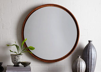 Round and other shaped mirrors are no problem.  Excellent as an accent piece or just a change of pace.